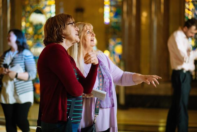 Visitors enjoy a guided tour at Freemasons' Hall